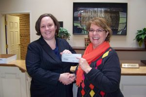 Maggy Gregory, Danville Bar Association treasurer, presents their donation to Debra Dodson, Executive Director of The Community Foundation.